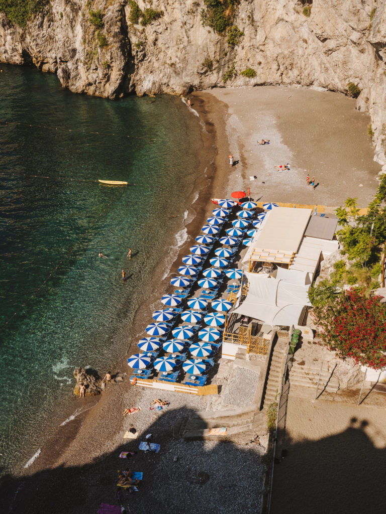 #airbnbmagazine #kayak #mediterranean #costaamalfitana #amalfi #umbrellas #blue #beach