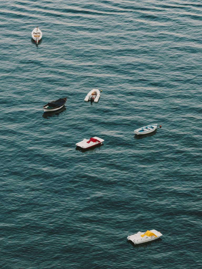 #airbnbmagazine #kayak #mediterranean #costaamalfitana #beach #boats #vietrisulmare #tourism #travel