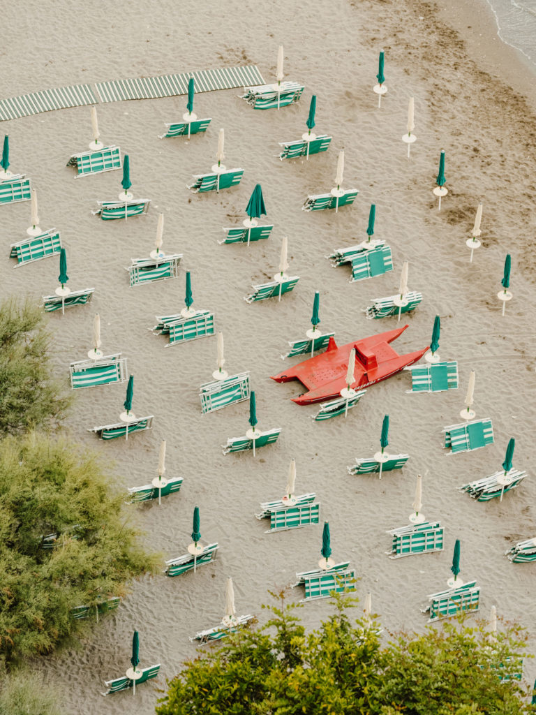 #airbnbmagazine #kayak #mediterranean #costaamalfitana #beach #umbrellas #vietrisulmare #green