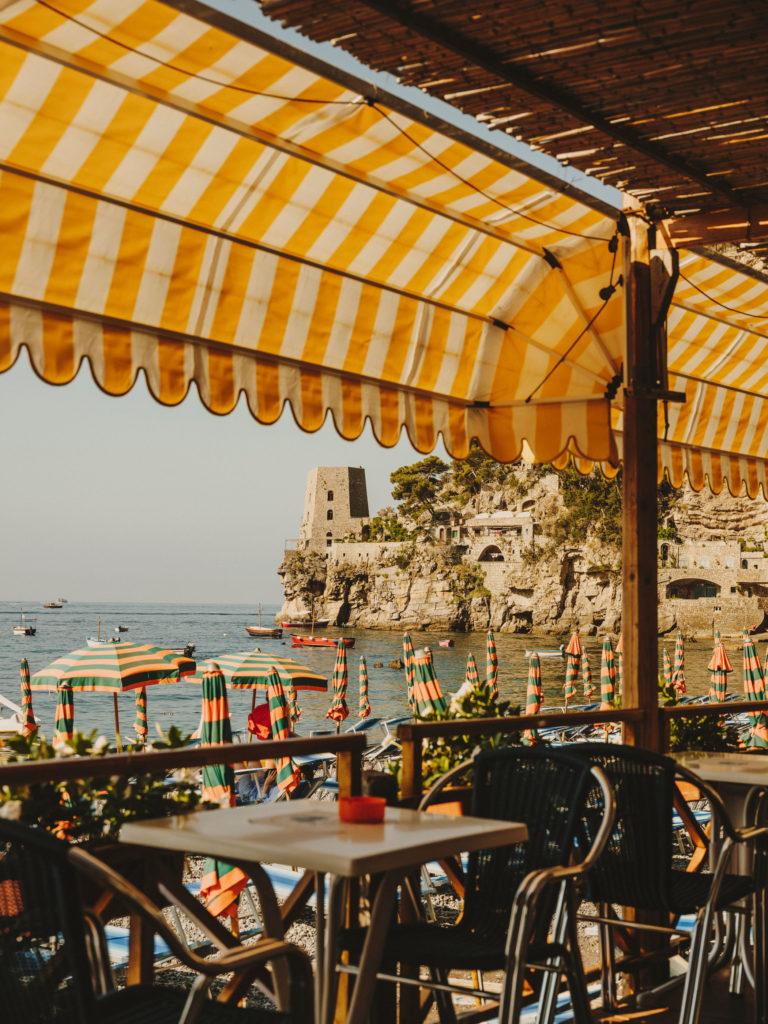#airbnbmagazine #kayak #mediterranean #costaamalfitana #positano #umbrellas #yellow #beach