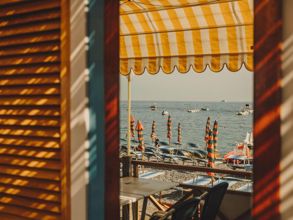#airbnbmagazine #kayak #mediterranean #costaamalfitana #positano #umbrellas #orange #beach